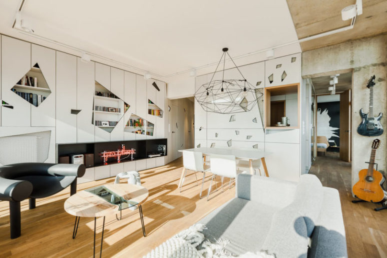 Geometric details all over the space and modern and eye-catchy furniture make the penthouse chic and create its character