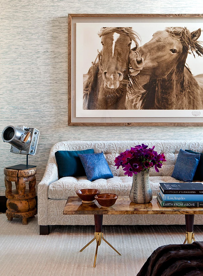 This textural sofa contrasts a stone coffee table and a gorgeous horse photo on the wall