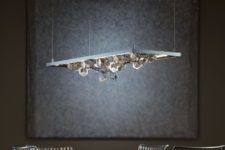 06 Winter pendant features multifaceted polished aluminum snowflakes that create a dramatic display of light and shadow