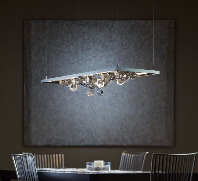 Winter pendant features multifaceted polished aluminum snowflakes that create a dramatic display of light and shadow