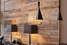 06 a reclaimed wood wall contrasts modern furniture and fixtures