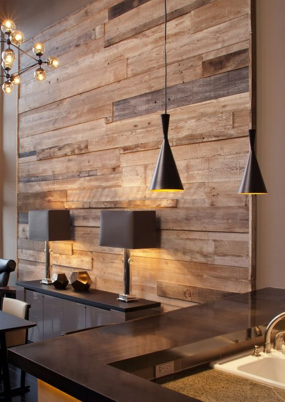 a reclaimed wood wall contrasts modern furniture and fixtures