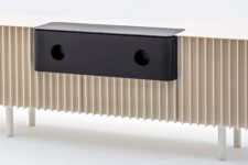 07 Piece F is a horizontal unit fronted wiht slats of Corian