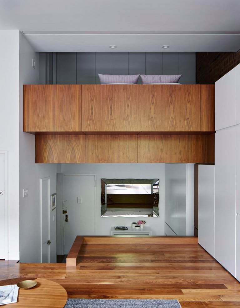 The bedroom is a platform one, it slightly expands over the lounge but looks rather private