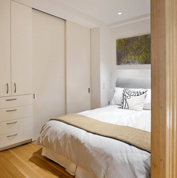 There are storage units in the corner of the bedroom drawers and those with sliding doors