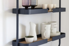 07 This framed two tier kitchen shelf is done in dark grey with cork, looks rather Scandinavian