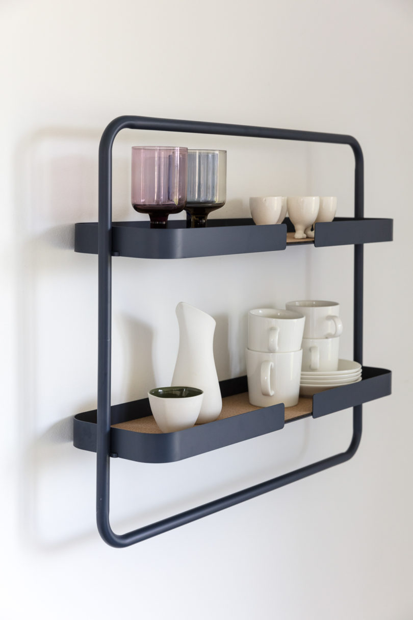 This framed two tier kitchen shelf is done in dark grey with cork, looks rather Scandinavian