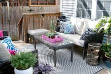 07 colorful outdoor living room on the porch with patterns, prints and potted greenery