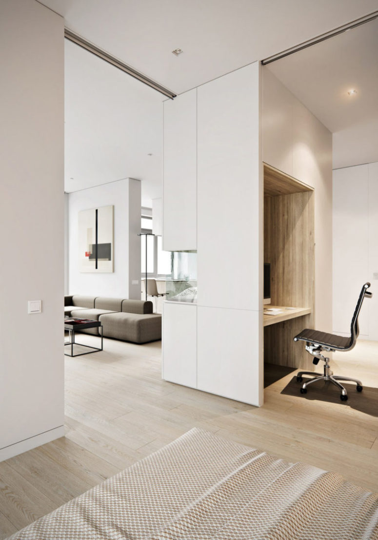 Light-colored wooden floors, white furniture and ceilings make the apartment feel more spacious