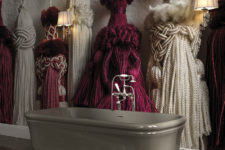 08 Unique 3D wallpaper showing giant tassels creates a bold look in the bathroom