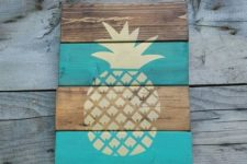 08 a weathered wood sign with a pineapple made with a stencil is easy