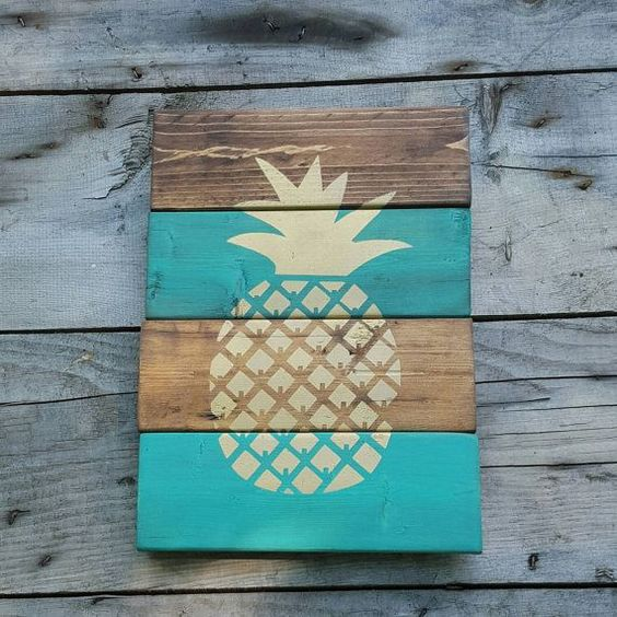 a weathered wood sign with a pineapple made with a stencil is easy