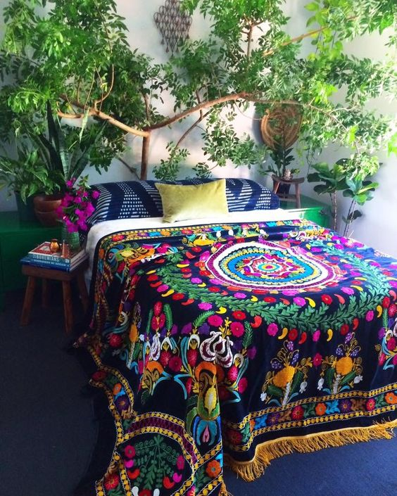 colorful printed bedspread with tassels and printed pillows