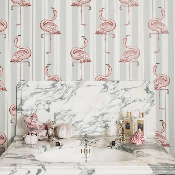 grey striped wallpaper with light pink flamingo prints for a girlish bathroom