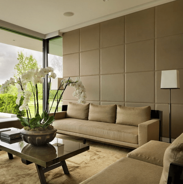 leather wall panels make the space look very chic and reduce the noise level