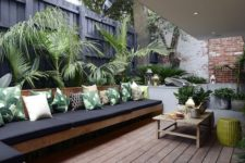 08 outdoor lounge with palm leaf print pillows to embrace the location