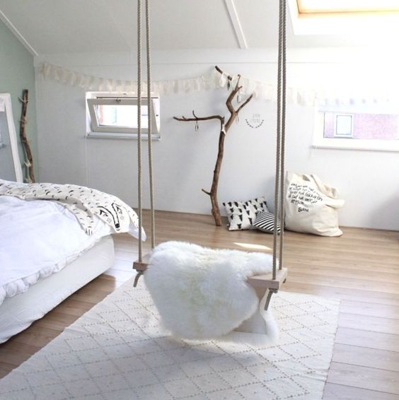 this cozy fur covered swing adds a comfortable feel to the room