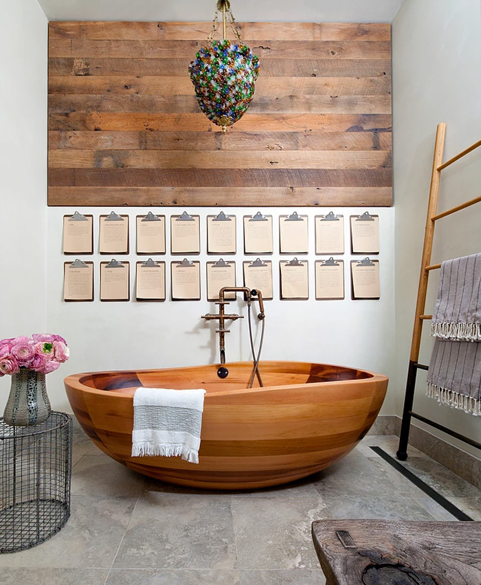 I love the colorful chandelier over the bathtub, it adds color to the space