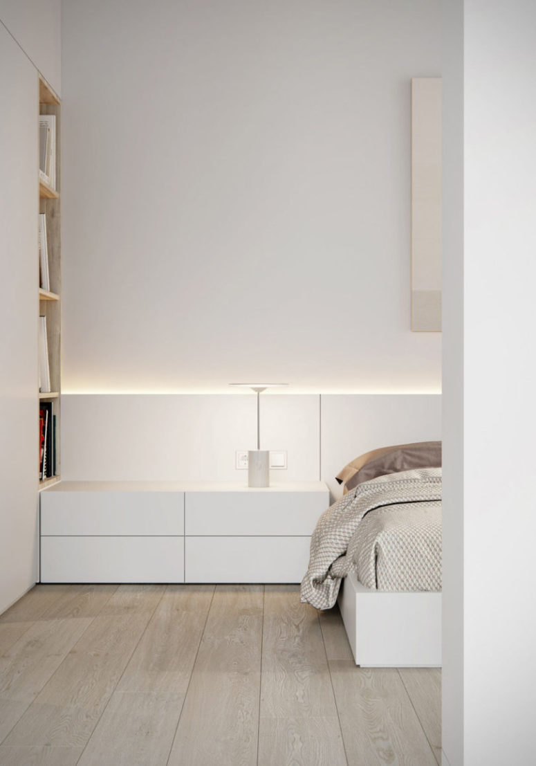 The bedroom is done in the same style, with sleek white furniture and several layers of light for maximal comfort