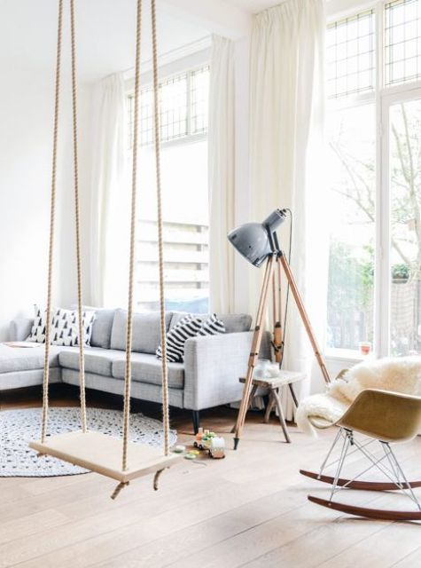 a cozy and light-filled living room with a swing to add a playful and relaxing touch