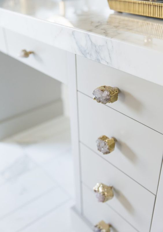 gilded geode knobs and a marble tabletop look very exquisite together