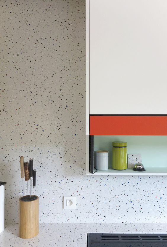 white trrazzo kitchen walls and countertops is a functional solution