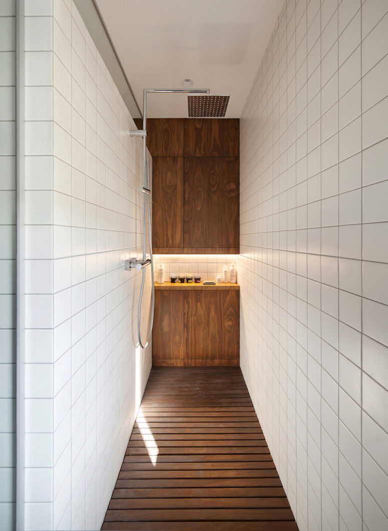 The shower has this grid floor designed specifically with the clients' dogs in mind