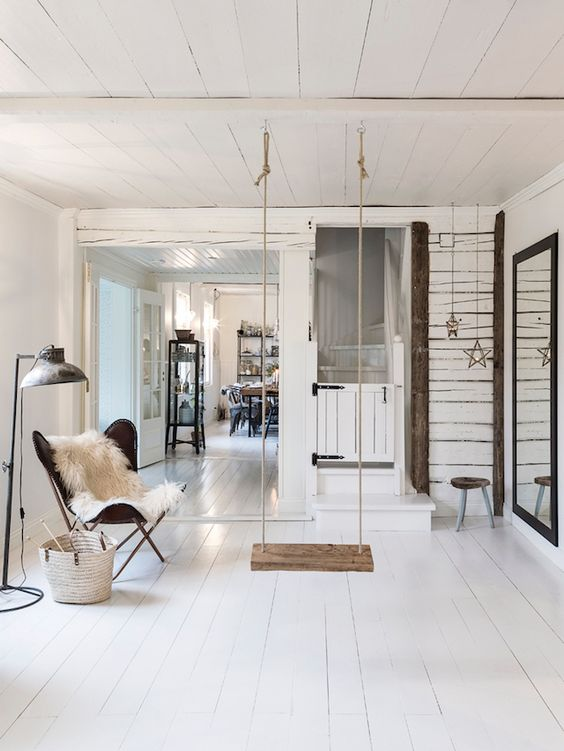 a Scandinavian living room with a swing as a focal point to make it dreamy and relaxing