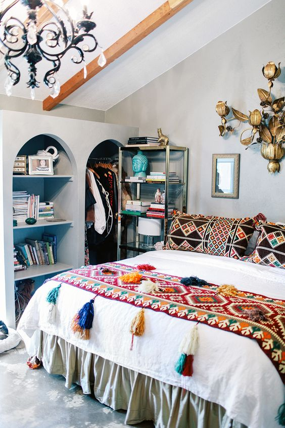 a couple of bold patchwork pillows and a colorful tassel throw can turn your bed into a boho one