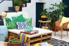 10 bold print pillows and a striped rug add cheer to this outdoor lounge