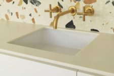 10 white terrazzo with large colored inserts as a backsplash for a white kitchen