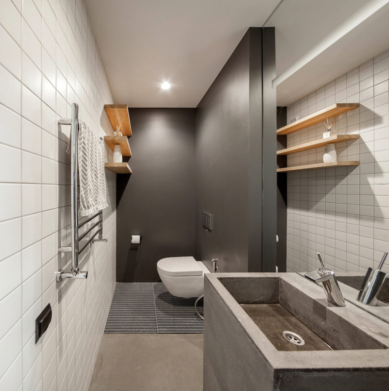 The guest bathroom is equally simplistic and stylish, being mainly focused on shades of gray