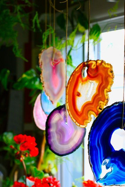 colorful geode hangers on the window will make your space play with colors