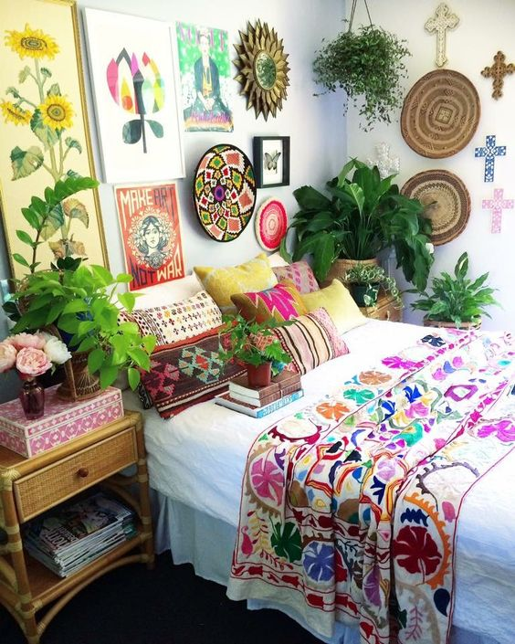 colorful printed pillow cases and a blanket in bold shades