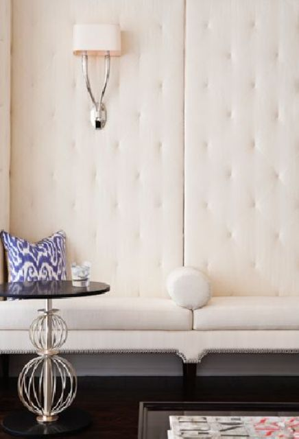 creamy upholstered walls make the space chic, light-filled and absorb the sound