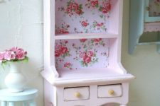 11 open white cupboard with floral wallpaper inside for a cute shabby chic look