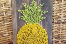 11 pineapple string art on a board can be DIYed