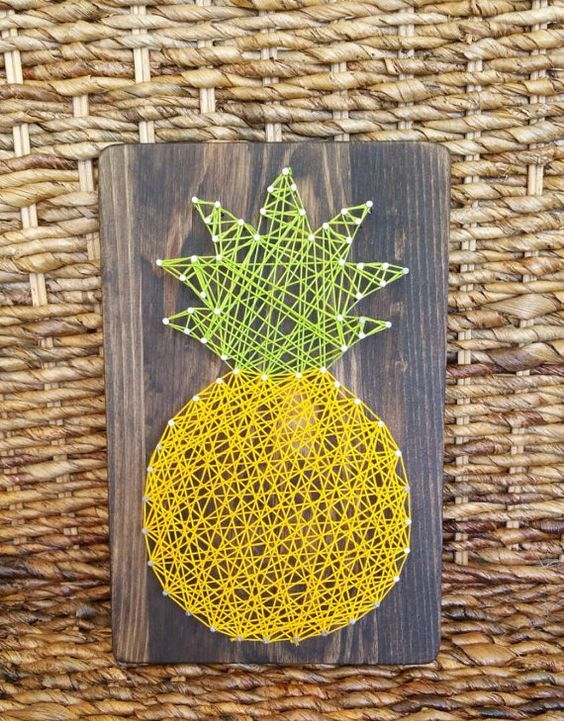 pineapple string art on a board can be DIYed