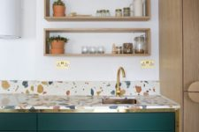 12 a colorful terrazzo kitchen countertop and emerald and gold cabinets look stylish and chic