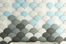 12 scallop acoustic penals in white, grey and blue create an interesting wall art
