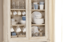 13 a neutral vintage cupboard with chicken wire instead of glass in doors