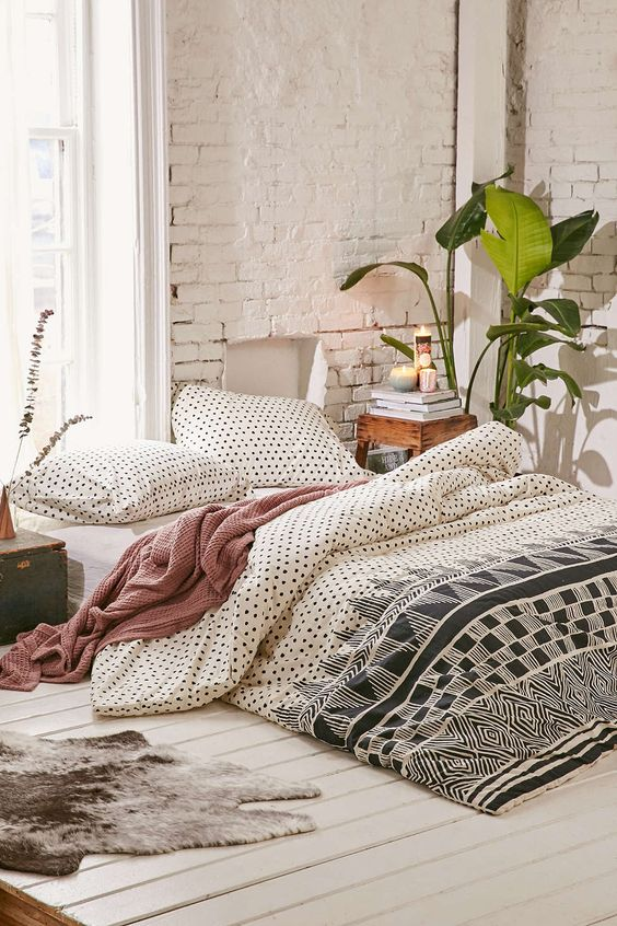 black and white polka dot and graphic print bedding can fit also a mid-century bedroom