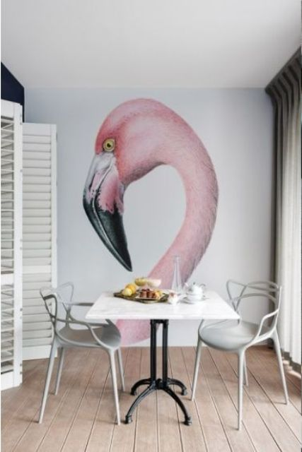 oversized pink flamingo wall mural to make a simple dining space eye-catchy