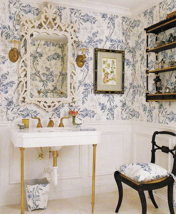 blue floral wallpaper for a vintage inspired powder room to achieve a refined look