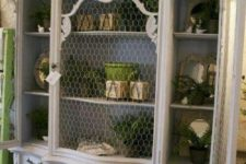 16 oversized white shabby chic cupboard with chicken wire instead of glass that gives it a unique feel