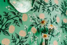 17 bold green wallpaper with yellow floral prints screams spring and summer and adds cheer to the bathroom
