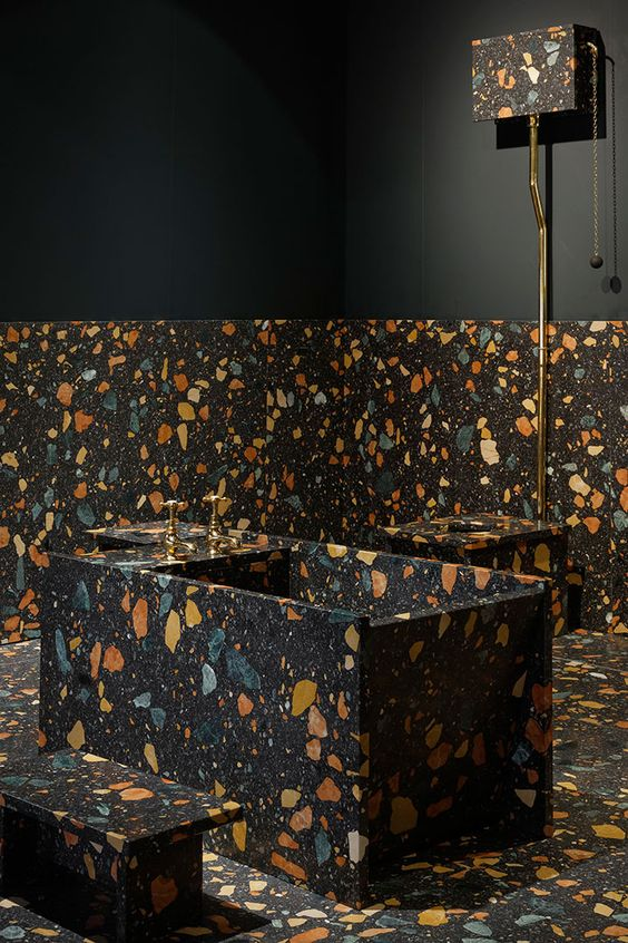 dark terrazzo with colorful inserts for the bathroom floor, walls and the bathtub itself