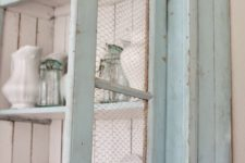 17 mint cupboard with chicken wire and white paint insde for a contrasting look