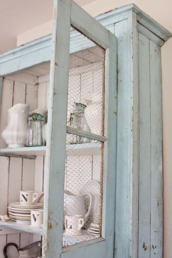 mint cupboard with chicken wire and white paint insde for a contrasting look