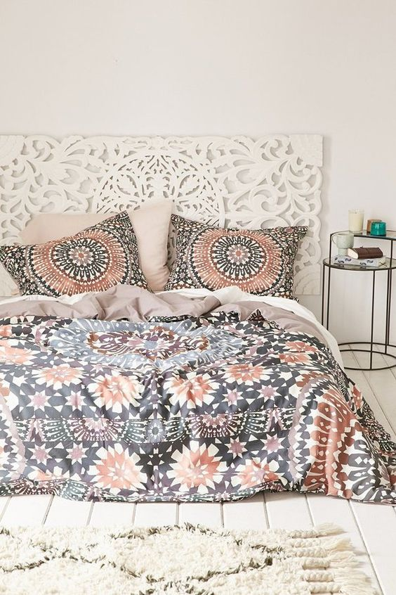 copper, black and white bold printed bedding echo with the headboard